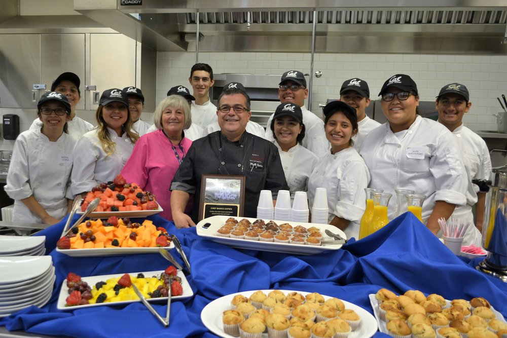 "California High School's Culinary Arts Academy dedicate a ""kitchen"" to Chef Marco Zapien, executive chef and owner of Zapien's Salsa Grill and Taqueria in Pico Rivera during a dedication ceremony on Sept. 28. Zapien poses with senior culinary students who prepared a continental breakfast for the occasion."