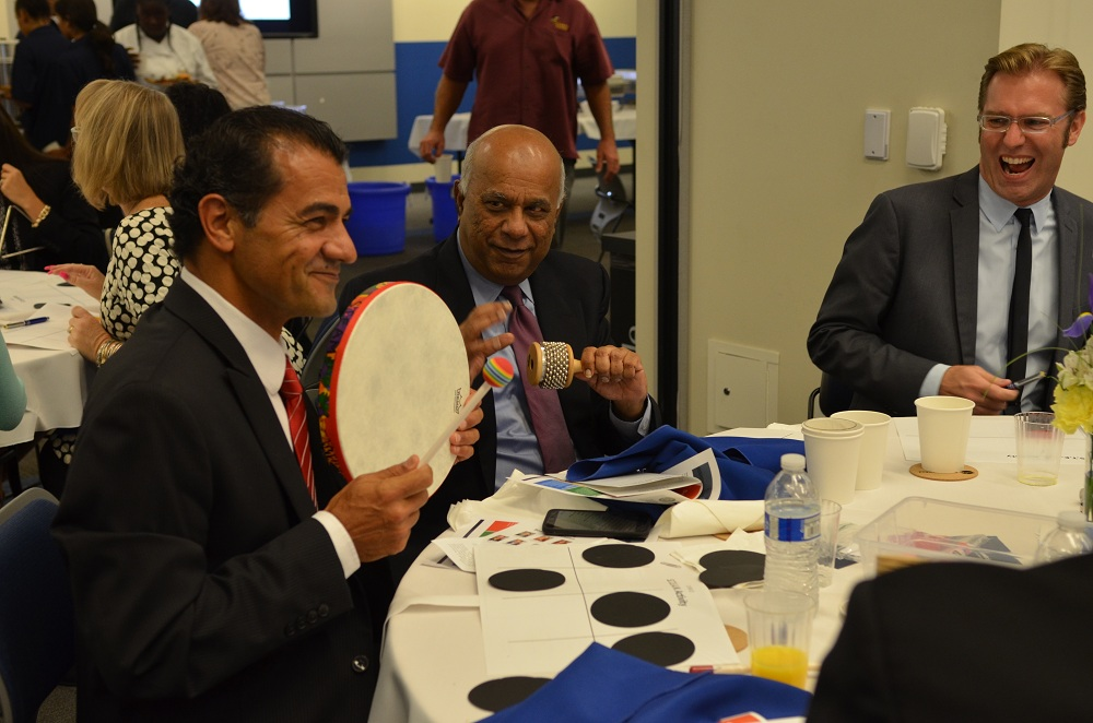 Downey public works director Mohammad Mostahkami, finance director Anil Gandhy and space center executive director Ben Dickow participate in a group activity at Friday's State of the Schools event. Photo courtesy DUSD