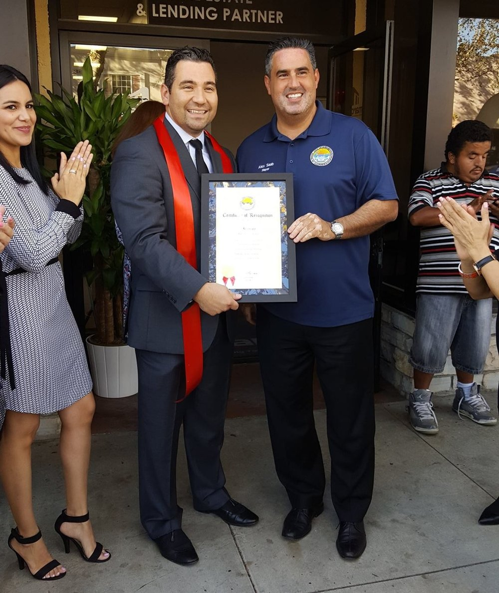 Carlos Martinez, left, received a city proclamation from Mayor Alex Saab. Photo courtesy Downey Chamber of Commerce.
