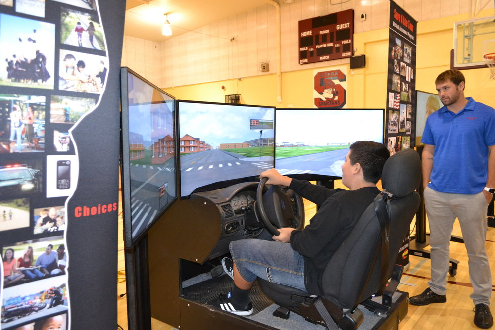 A Frontier High School student uses drinking-and-driving simulator during a Save A Life Tour assembly held Nov. 2 to highlight the dangers of impaired driving.
