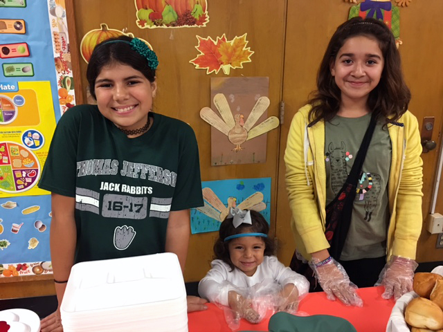 Thomas Jefferson Elementary students and siblings helped serve during the school's inaugural TJ Turkey Night. More than 100 parents and students completed crafts and 327 community members dined on a full Thanksgiving meal during the Nov. 16 event.