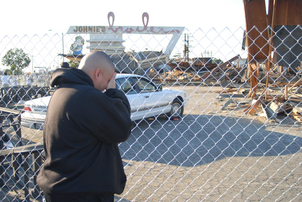 Fans of Johnie's Broiler grieve after the restaurant's demolition in 2007. Photo by Art Montoya
