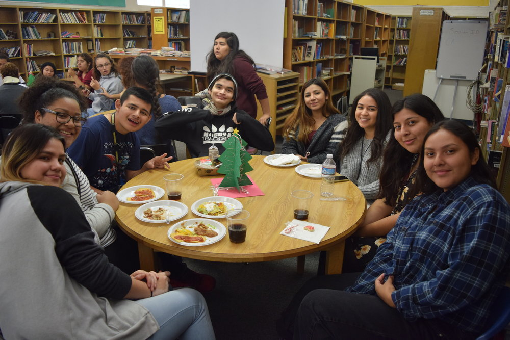 Members of Santa Fe High School's Chieftain Friends share a laugh with their classmates at a holiday party held in the school library on Dec. 8. Chieftain Friends is a volunteer social enrichment program that brings together Santa Fe's students in the special education program with general education students. The students meet once-a-week for lunch throughout the school year.