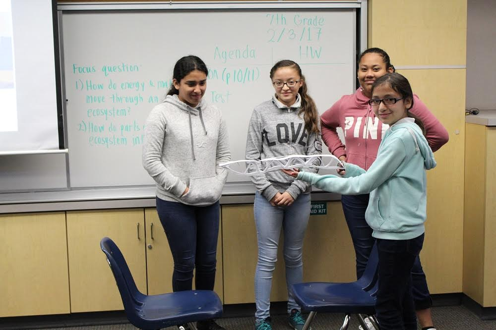 Paramount Park Middle School sixth-graders display their airplane wing prototypes after working with Boeing engineers to construct the project.