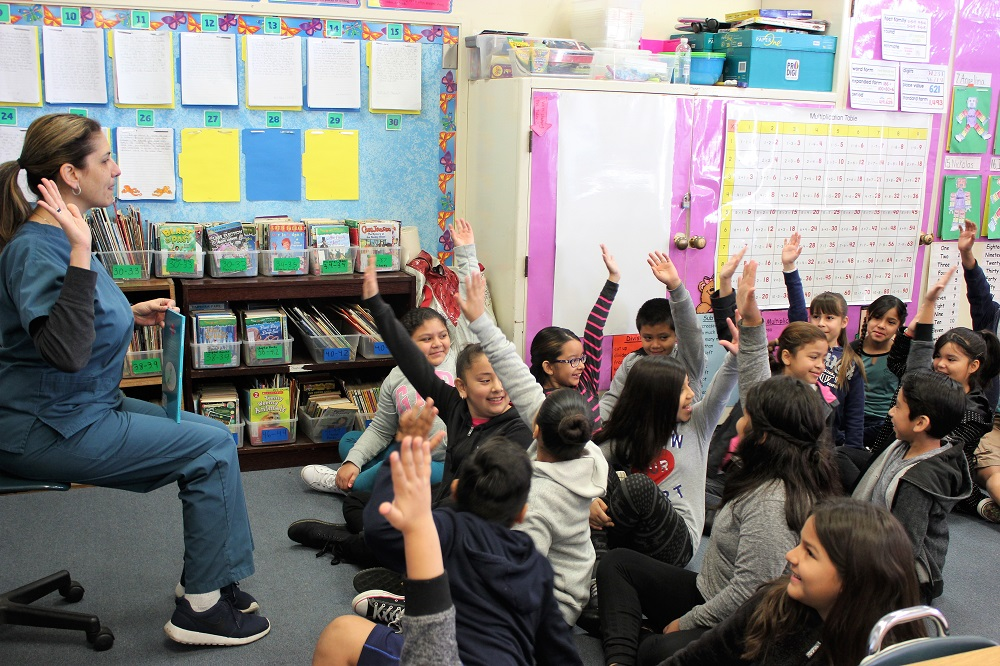 Santa Fe Springs City Council member Juanita Trujillo visits with a class at Rancho Santa Gertrudes Elementary School on March 2 to celebrate Read Across America, the annual reading awareness program.