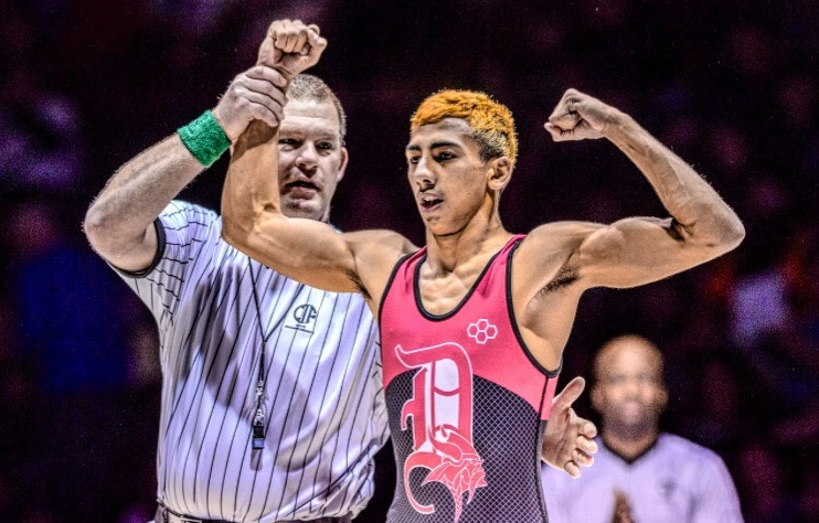 Jonathan Prata, a junior at Downey High, won the school's first state wrestling title. He now advances to the national championship in Pennsylvania, where he will compete in the 106-lb. division. Photo courtesy Downey High