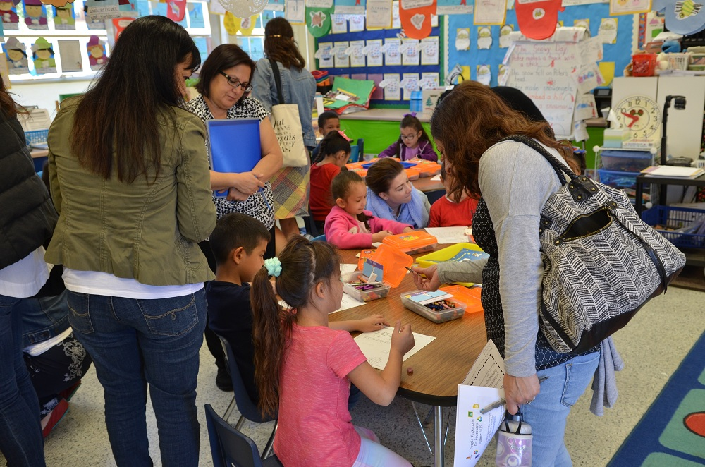 Outside educators interact with students at Lewis Elementary. Photo courtesy DUSD