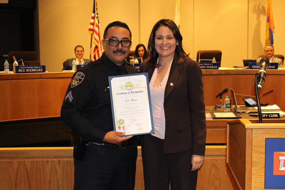Downey Police Cpl. Ed Hano with Councilmember Blanca Pacheco at Tuesday's City Council meeting.