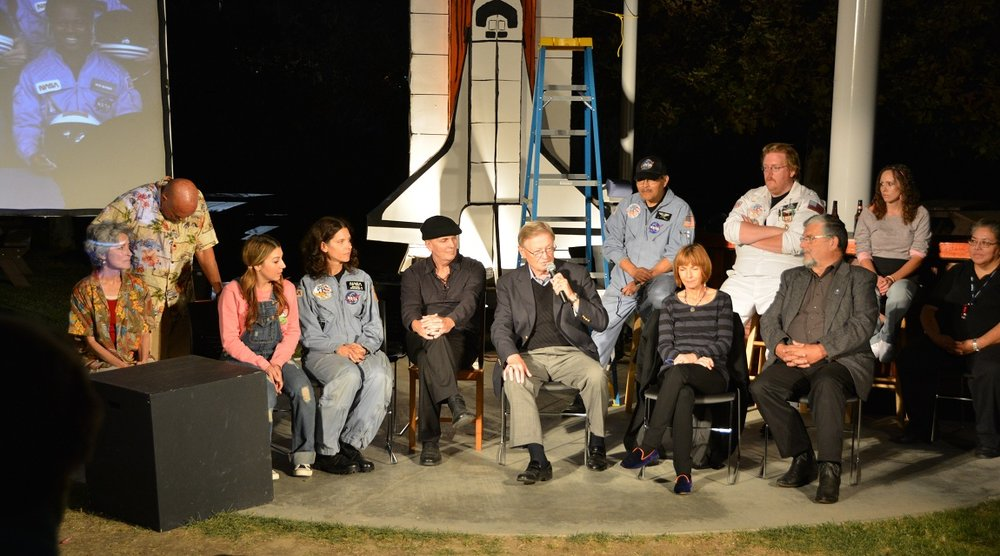 "Cast and speakers at a Q & A session on the set of ""Defying Gravity"" after the closing performance in 2014. Playwright Jane Anderson is second from the right, front row. Photo by Carol Kearns"