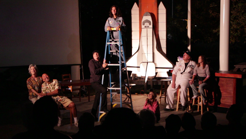 "Concluding scene of the 2014 production of the play ""Defying Gravity"" at the Columbia Memorial Space Center. Photo by Carol Kearns"