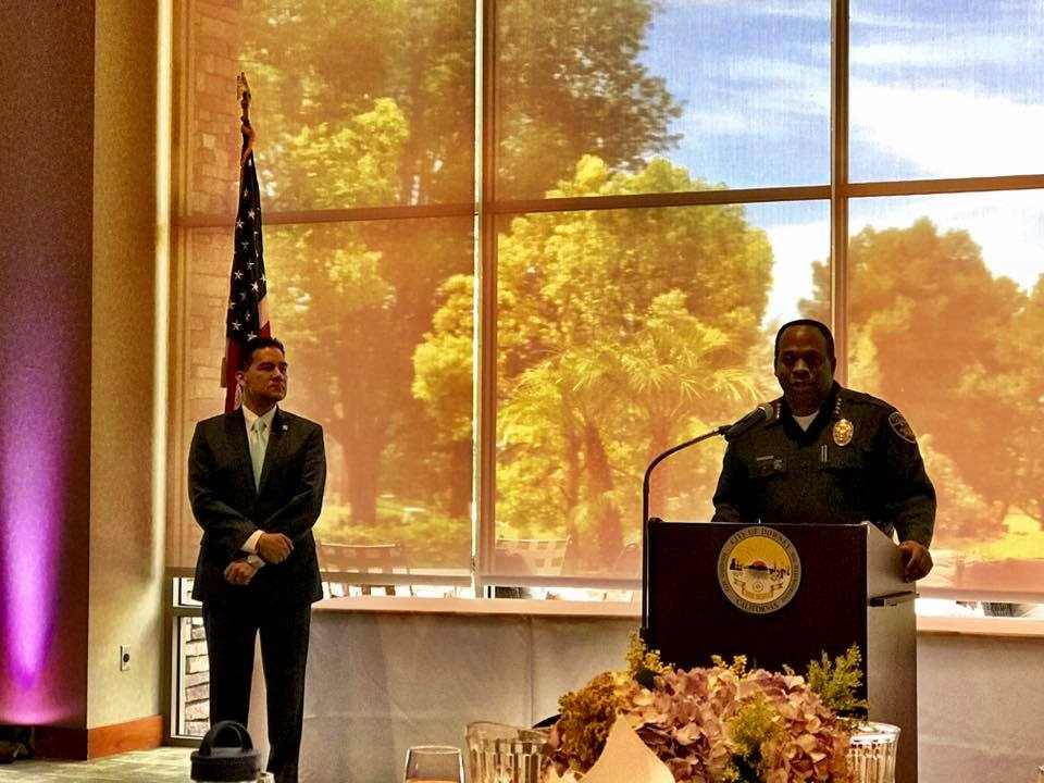 Police Chief Carl Charles speaks at Wednesday's State of the City address as Mayor Fernando Vasquez looks on. Photo by Mario Guerra