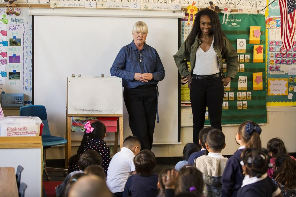 "Mark Twain Elementary teacher Judy Vellegas (left) and tennis star and Olympic gold medalist Venus Williams speak to Vellegas' class of kindergarteners after Williams surprised Vellegas as part of a California Lottery ""Back to the Start"" social media video campaign."