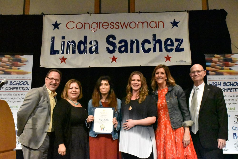 La Serna High School junior Elizabeth Islas took the top prize at the 38th District for the 2017 Congressional Art Competition on April 13. Islas, center, is pictured with Superintendent Martin Plourde, left, Rep. Linda Sanchez, art teacher Michelle Patino, Principal Ann Fitzgerald and Board of Trustees President Tim Schneider.