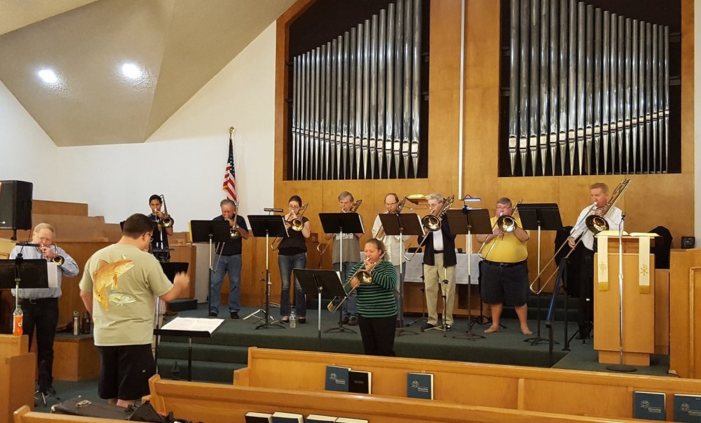 Moravian Trombone Choir practicing for its performance at the closing service of the Downey Moravian Church, Sunday, June 4. Photo by Carol Kearns