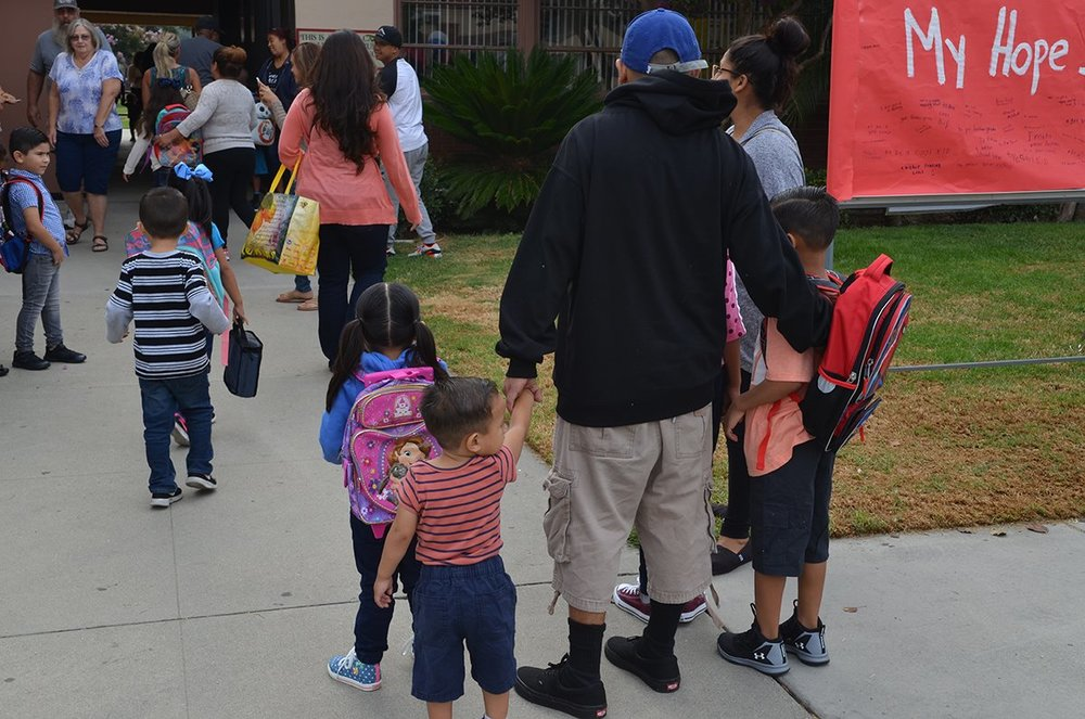 Students arrive for the first day of school at Lewis Elementary. Photo courtesy DUSD
