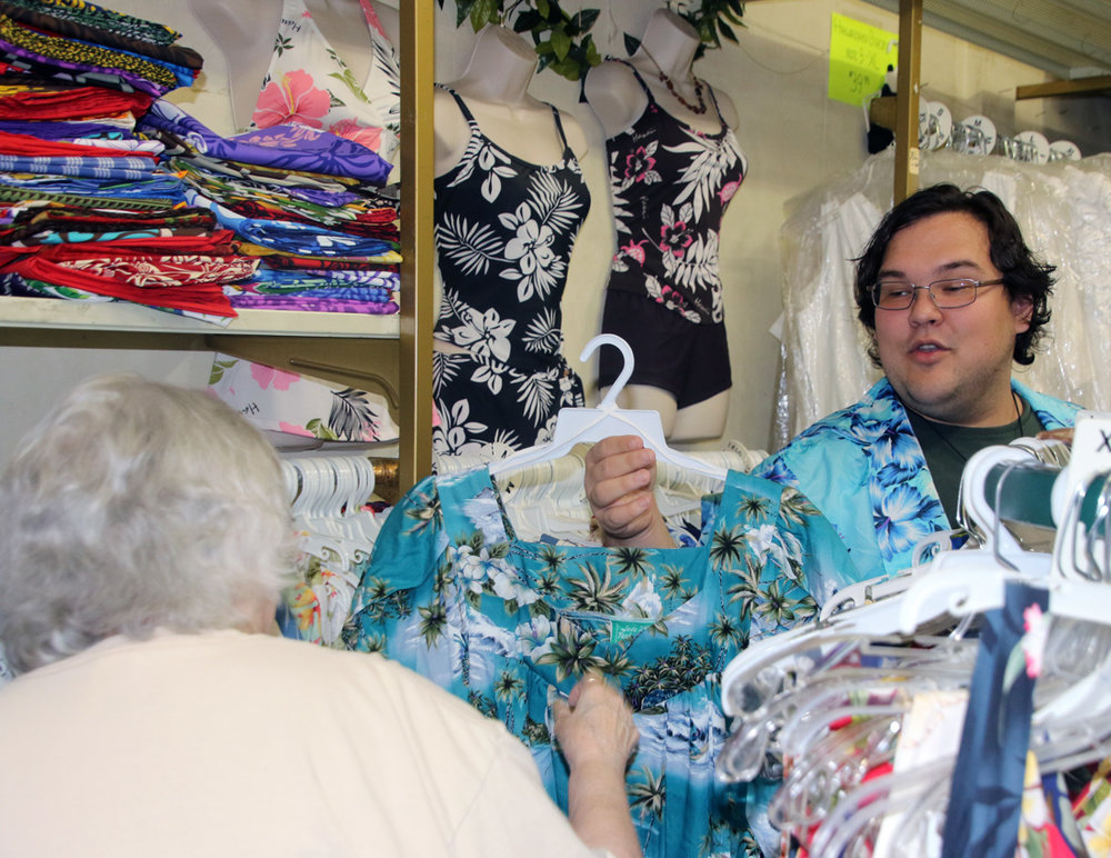 Orloff helps a customer.