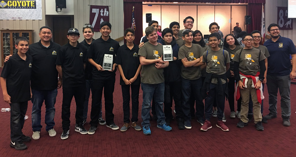 Stauffer Middle School's Spartan Design robotics team and Warren High School's Robotics Club both pose with their Excellence Award trophies at the VEX Robotics Competition held Jan. 13 in Chino. These two teams, along with an additional Spartan Design team, will now be competing at the state level in March.