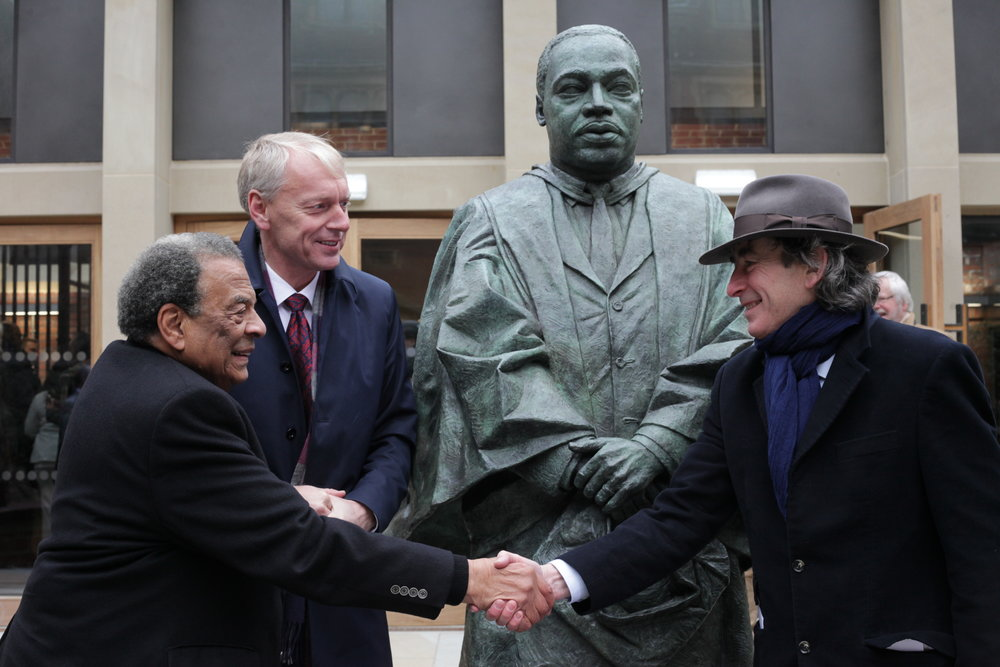 Ambassador Andrew Young (l.) shaking hands with sculptor Nigel Boonham at the unveiling of King's statue, November 2017. Professor Chris Day, Vice Chancellor and President of the university looks on. Photo from Newcastle University