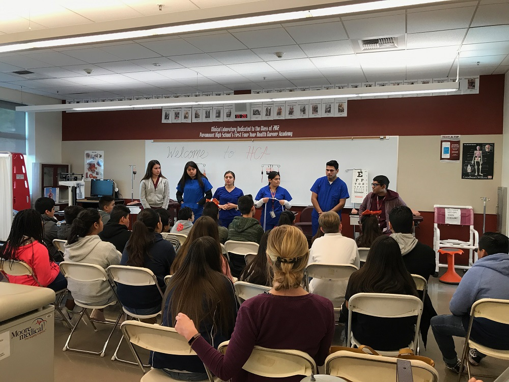 Students from Paramount High School's medical pathway program speak with Alondra Middle School students who visited the campus on Jan. 10. The Alondra students visited as part of the Project Lead The Way program, which offers classes for architecture, app creation, graphic design and medical to seventh- and eighth-grade students.