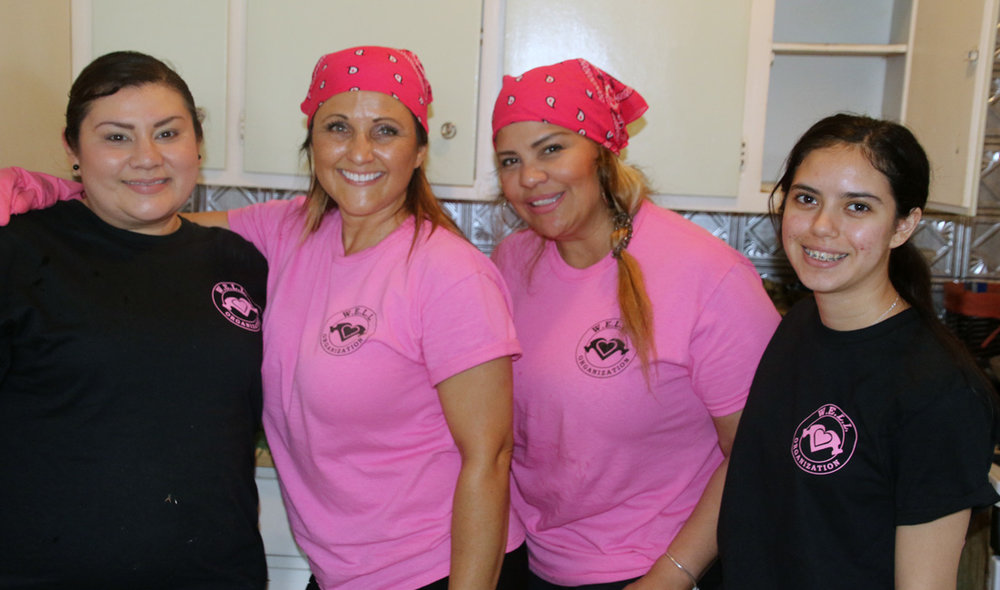 Denese Lopez, center left, with her team during a recent project in Downey. Photo by Alex Dominguez