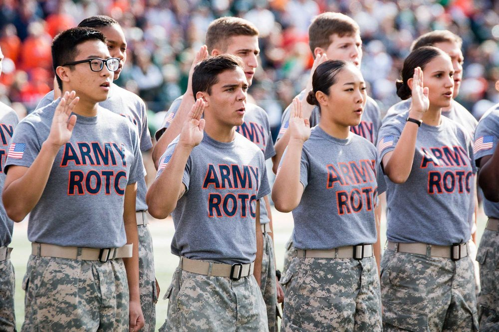 New members of the Army ROTC take the oath of enlistment during the first half of the game against Michigan State at Memorial Stadium on Saturday, November 5.
