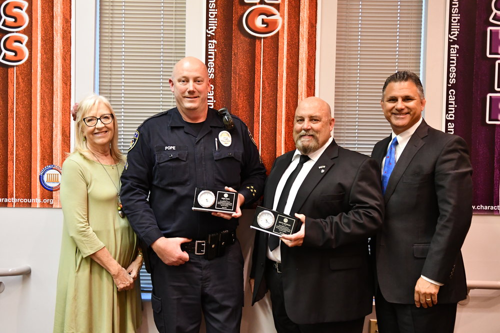 From left: school board president Bobbie Samperi, Cpl. Mike Pope, Cpl. Kevin Kendall and superintendent Dr. John Garcia. Photo courtesy DUSD
