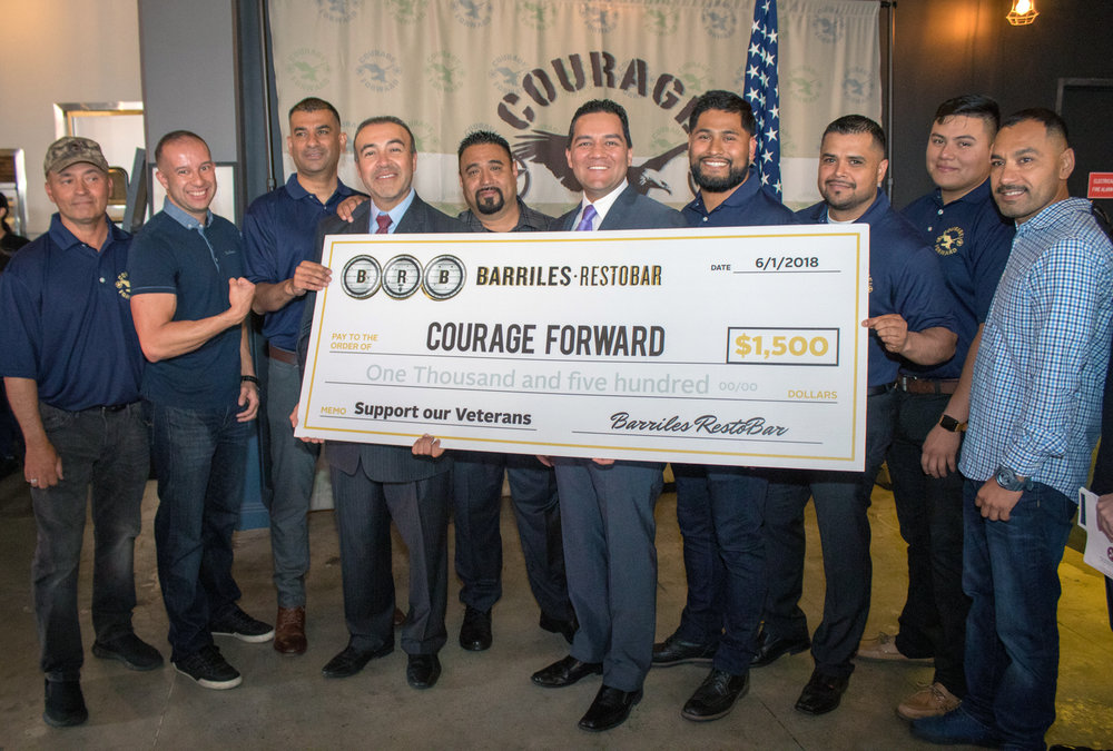 Barriles RestoBar made a $1,500 donation to veterans organization Courage Forward last week. Photo by Claudia Gomez