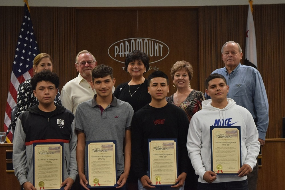 The City of Paramount honored Paramount High School students (front row, left to right): Juan Garza, Gabriel Orozco, Fernando Melgar and Anthony Farias for their heroic acts in helping fellow students injured in a March car accident.