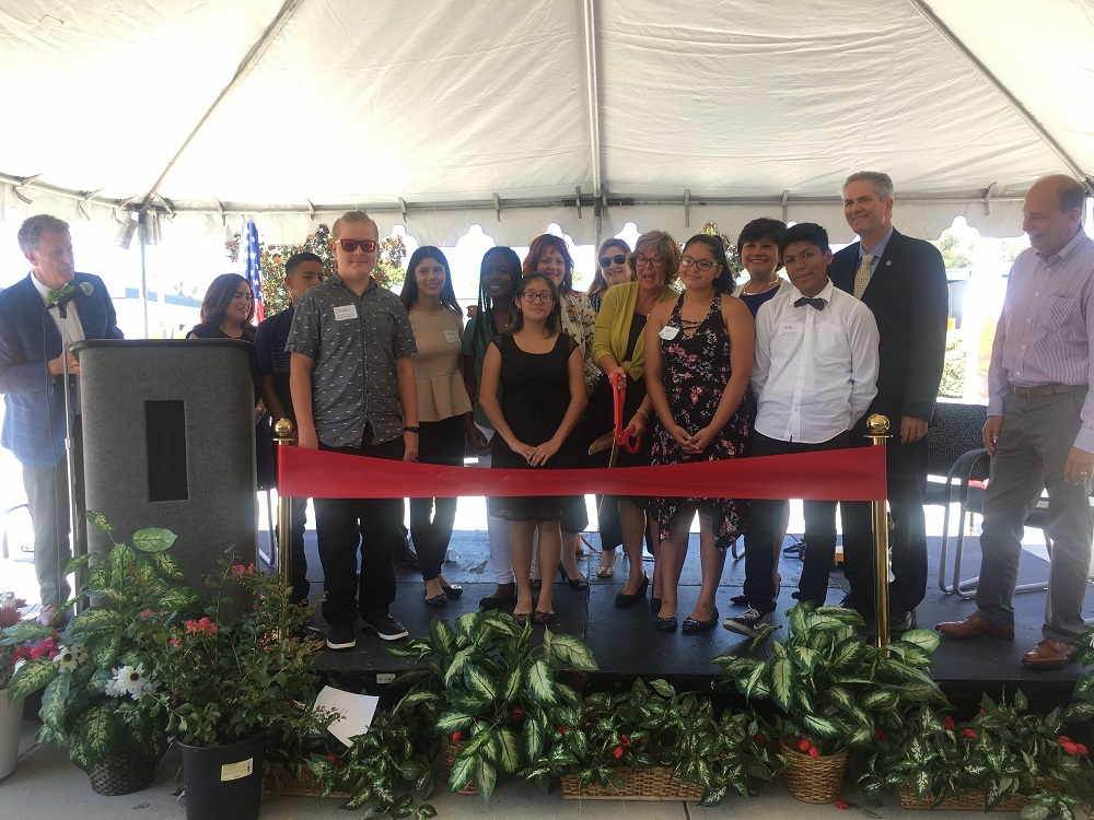 Odyssey STEM Academy incoming students and Paramount community leaders celebrate the school with a ribbon-cutting on Aug. 1