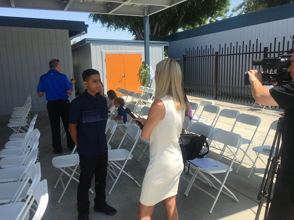 Odyssey STEM Academy incoming student Blue Phillips is interviewed by Lakewood CityTV channel 31 following the school's ribbon-cutting ceremony on Aug. 1.
