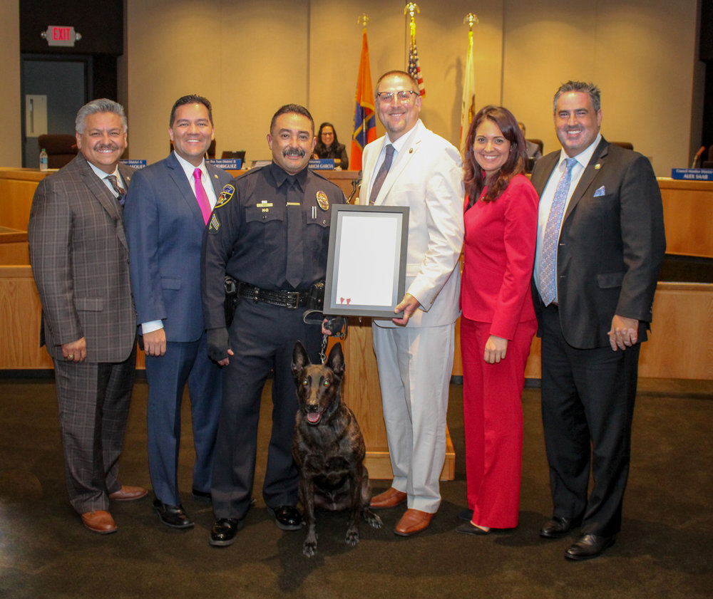 From left: Mayor Pro Tem Rick Rodriguez, Councilmember Fernando Vasquez, Cpl. Ed Hano, Mayor Sean Ashton, and council members Blanca Pacheco and Alex Saab.  Photo by Claudia Gomez