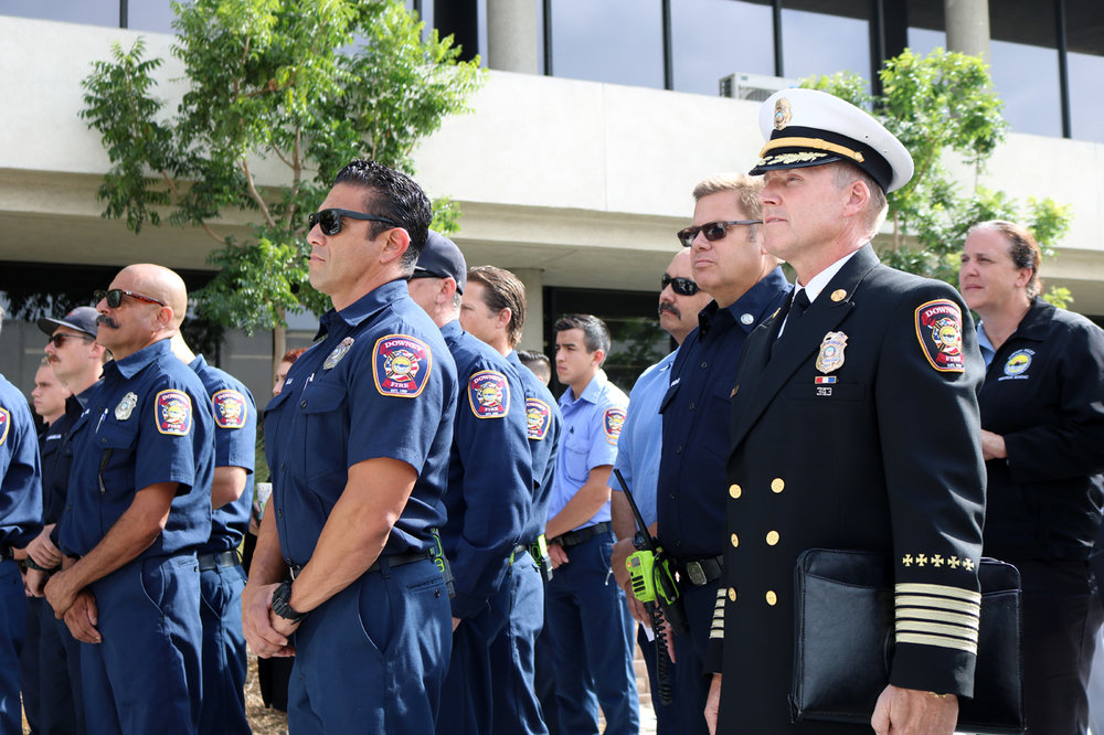 Downey firefighters pay their respects at a 9/11 ceremony Tuesday. Photo by Alex Dominguez