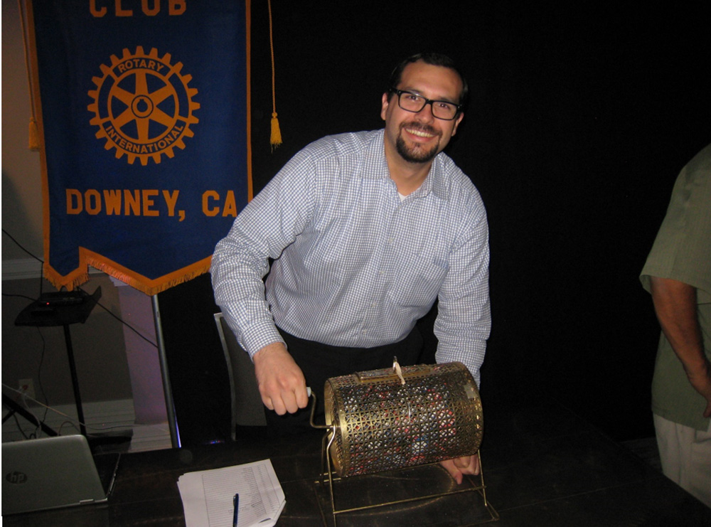 Alex Lopez mixing tickets at Downey Rotary's Winner's Night. Photo by Lorine Parks