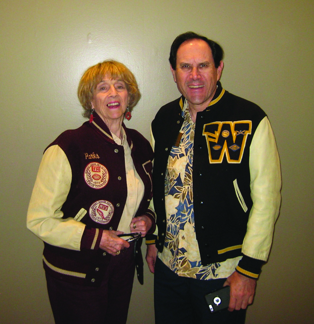 Lorine Parks, left, wears her son's 1975 Downey High letterman jacket. Dan Fox, Warren High class of 1974, shows off his letterman jacket as well.