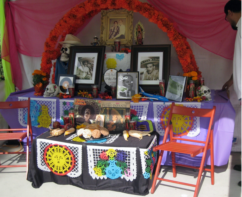 Lupita Infante's altar, paying tribute to her father and grandfather.