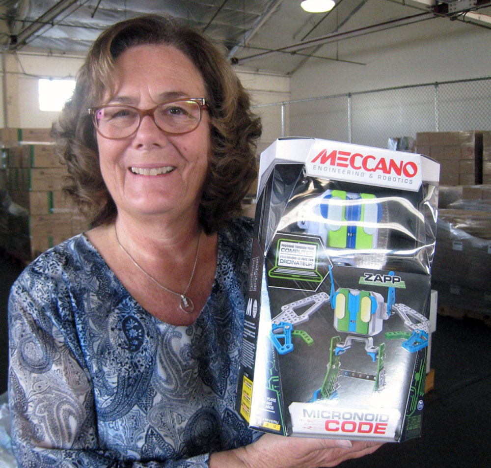 Rotary Club of Downey treasurer Barbara Lamberth displays a donated toy. Photo by Lorine Parks