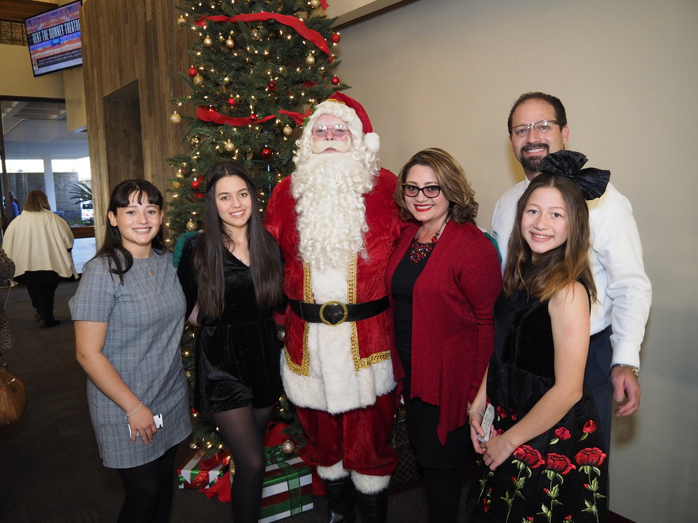"The Frometa family poses with Santa Claus prior to the ""It's Christmas in Downey"" show last month at the Downey Theatre. Photo by James ""Woody"" Woods."