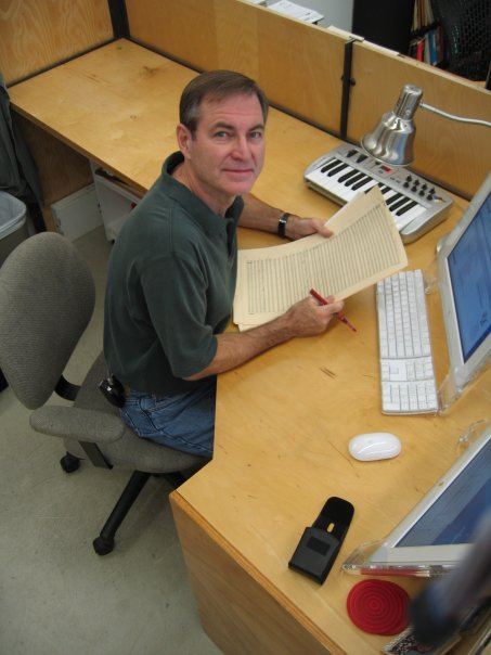 Lars Clutterham at his desk at JoAnn Kane Music Service.