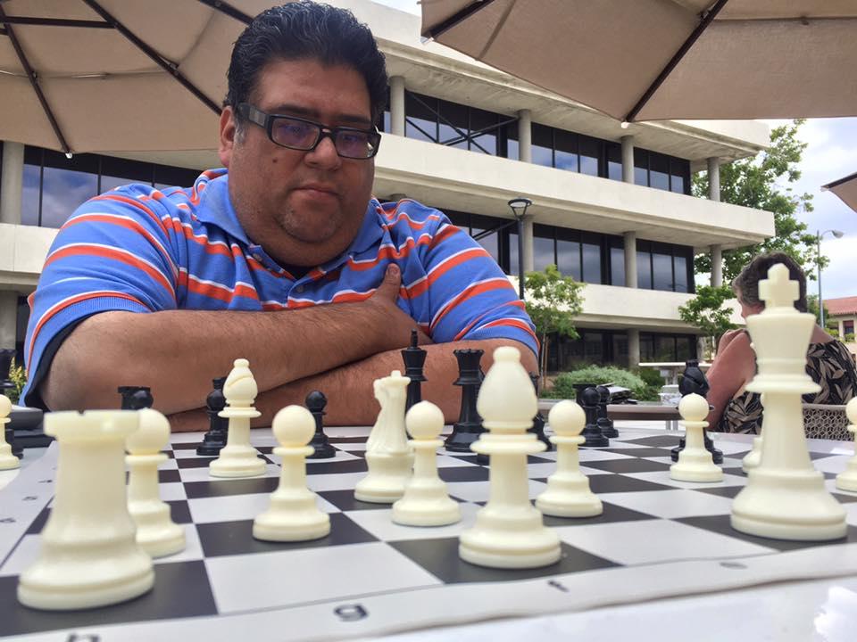 Ignacio Gonzalez plays chess at Vazza Cafe in Downey. Photo by Michael Chirco