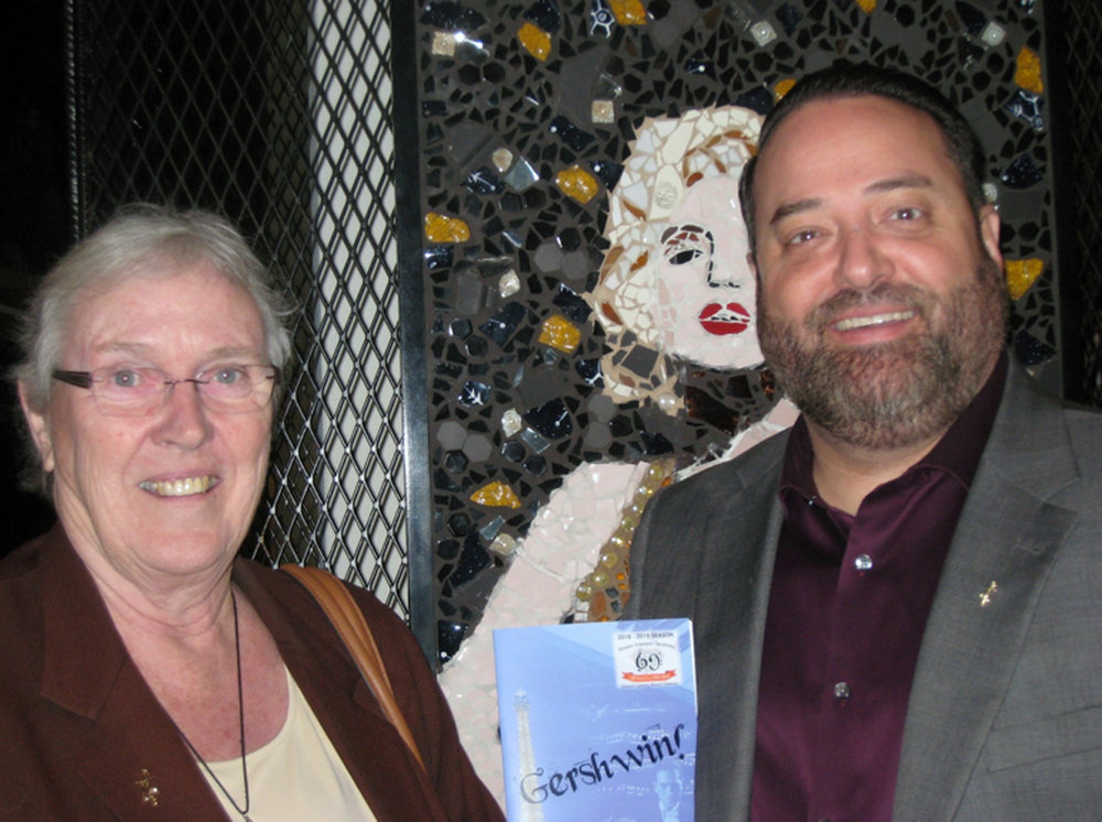Sister Eymard Flood and Chad Berlingherei. Lindsay Yost's mosaic of Marilyn Monroe looks over Chad's shoulder. Photo by Lorine Parks