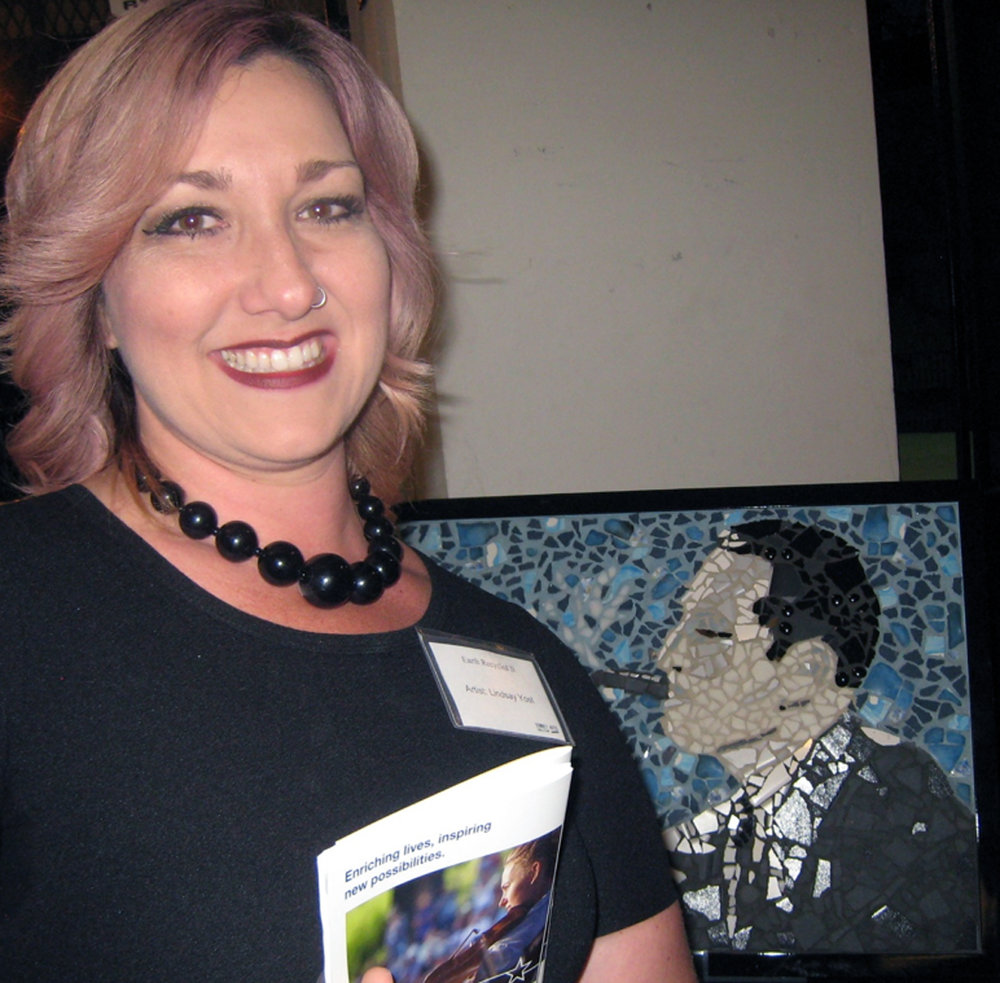 Lindsay Yost and her Gershwin mosaic. Photo by Lorine Parks