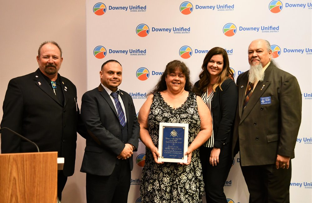 Old River Elementary School's Lucy Atlas accepts her Masonic Teacher of the Year plaque from the Downey United Masonic Lodge 220. From left to right: Stephen White, Downey United Masonic Lodge 220 Junior Warden; Ralph Lopez, Downey United Masonic Lodge 220; Lucy Atlas; Caryn Jasich, Old River Principal; and David Olmedo, Downey United Masonic Lodge 220 Senior Warden.