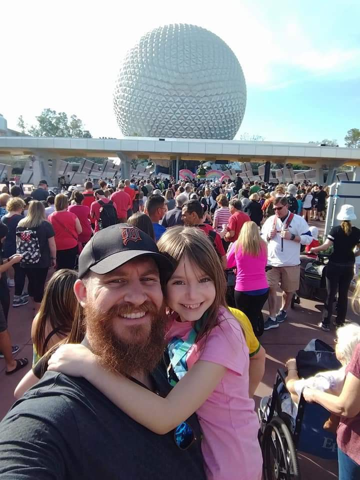 My husband and daughter wait to enter Epcot.