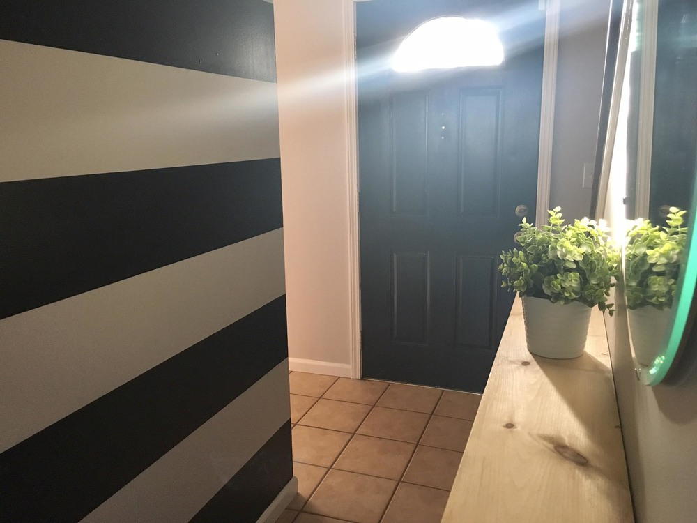 striped wall // black and white stripes // entryway