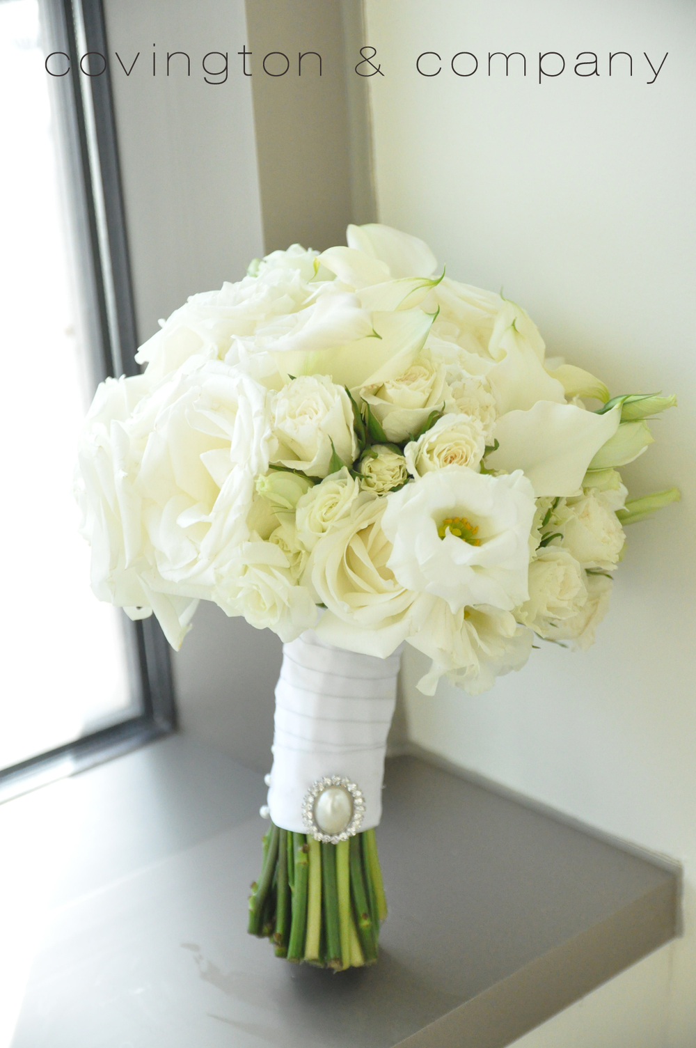 White Rose_Lisianthus_Pearl Brooch Bouquet.jpg