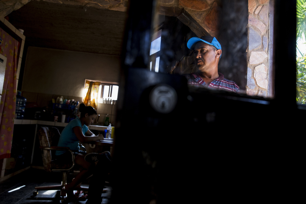 José Alberto Cosillos Bustamante, 42, looks inside his home in Ures, Sonora, one of seven municipalities in the Sonora River Basin. The area was contaminated by a mine spill in August 2014, affecting more than 22,000 people along 200 miles of the Sonora River.