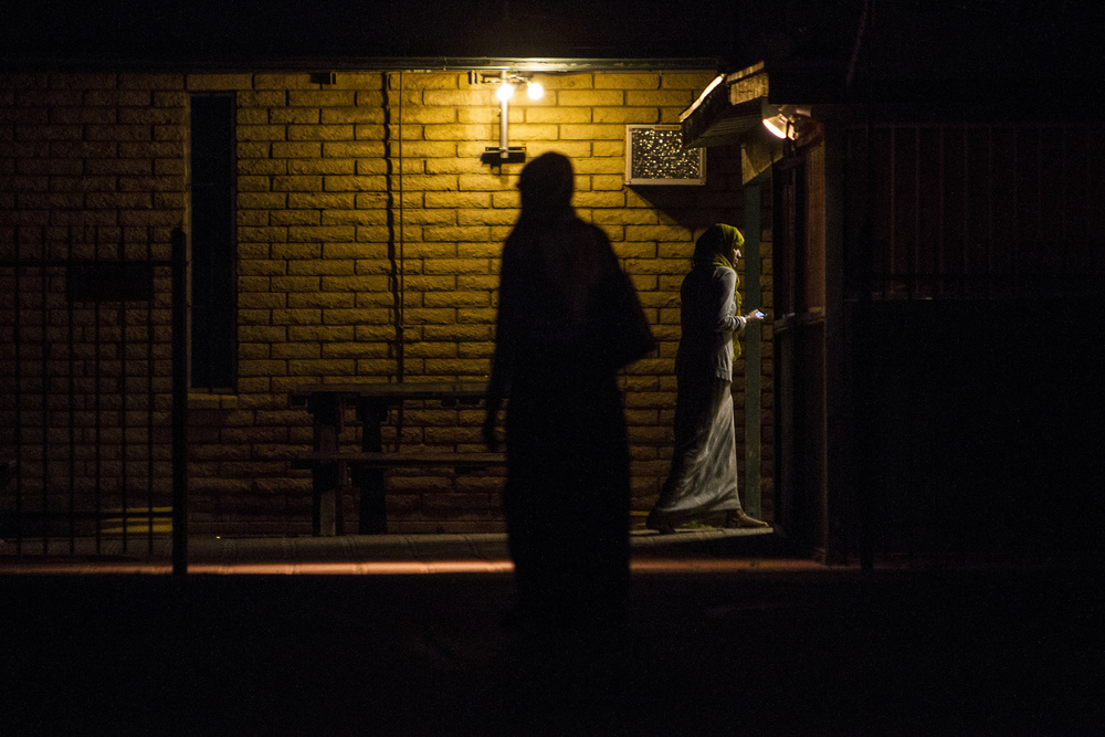 A woman walks into an Islamic community center after an anti-Islam protest was held outside a mosque on Friday, Jun. 29, 2015 in Phoenix. The protest, which was in response to a Prophet Mohammed cartoon contest in Dallas that resulted in the deaths of two gunmen, drew national attention.