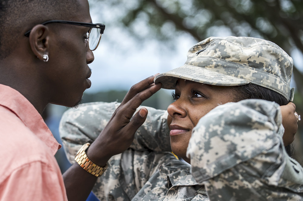 Nicholas Johnson touches Spc. Chasidee Moultry's cap after the Alabama National Guard's 1670th Transportation Company deployment ceremony on Saturday, Jun. 18, 2016 at the Eufaula Community Center in Eufaula, Ala.