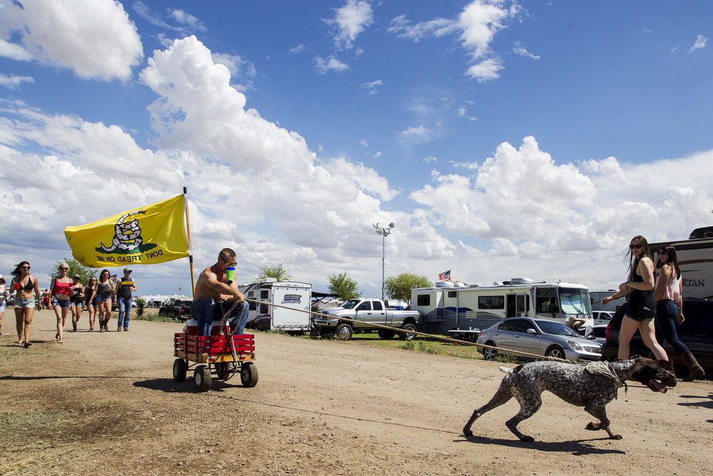 Colin Jingle is pulled in a wagon by his dog, Pepper, during Country Thunder in Florence, Ariz.