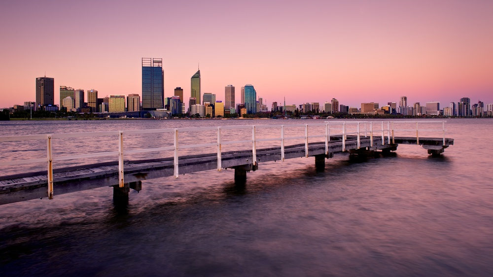 The skyline of Perth, Western Australia at sunset.